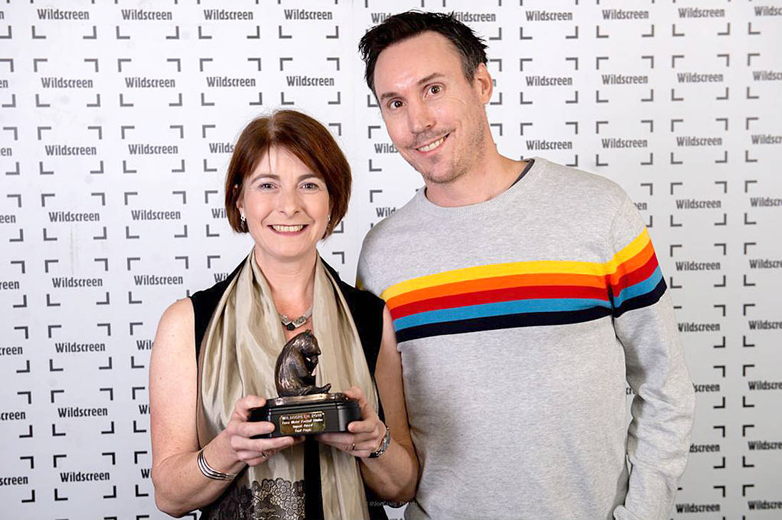 Mike McKinlay and Isabelle Groc accept their award at the Wildscreen Panda Awards, Oct 19. - Credit: Wildscreen Film Festival.