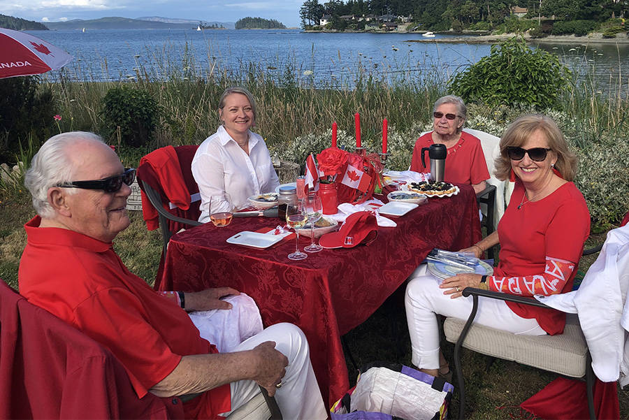 Guests at a miniature Dinner en Rouge brought their own food, dishes and cutlery in order to help maintain physical distancing. Tables were placed eight feet apart so groups would not intermingle. (Courtesy of Nigel Scott)